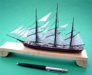 Rigging a miniature tea clipper with wire.JPG