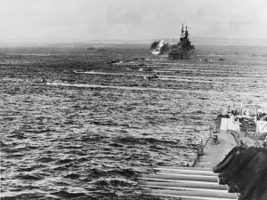 1280px-LVTs_move_toward_Saipan,_past_bombarding_cruisers,_on_15_June_1944_(80-G-231838).jpg